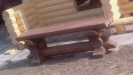 Лавочка из оцилиндрованного бревна
